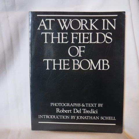 Image for AT WORK IN THE FIELDS OF THE BOMB